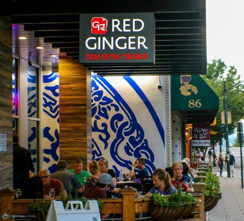 Guests sitting outside Red Ginger in downtown Asheville